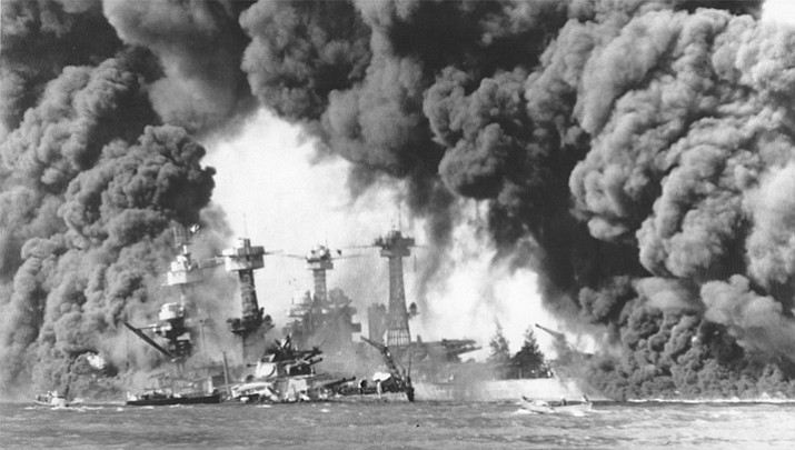 Smoke billows from U.S. ships hit by bombs during the Japanese air attack on Pearl Harbor, Hawaii on December 7, 1941. (National Archives and Records Administration)