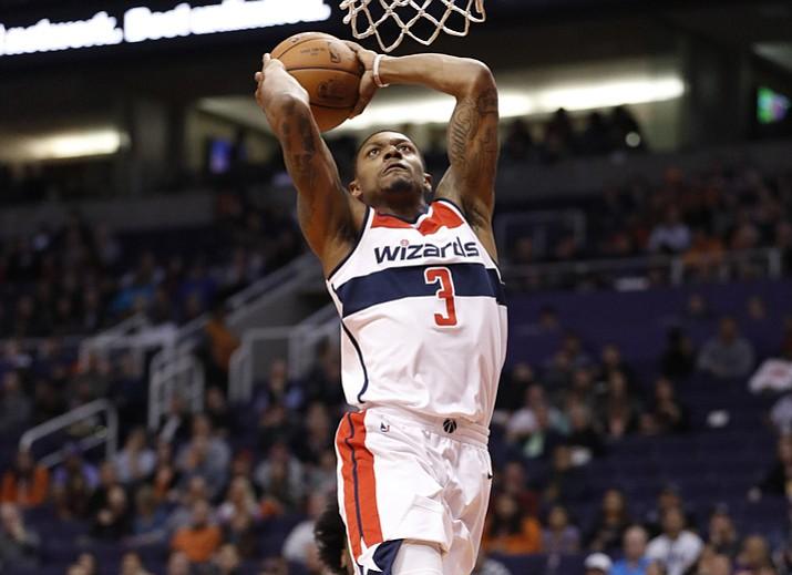 Washington Wizards guard Bradley Beal (3) dunks against the Phoenix Suns during the first half of an NBA basketball game, Thursday, Dec. 7, 2017, in Phoenix. (Matt York/AP)