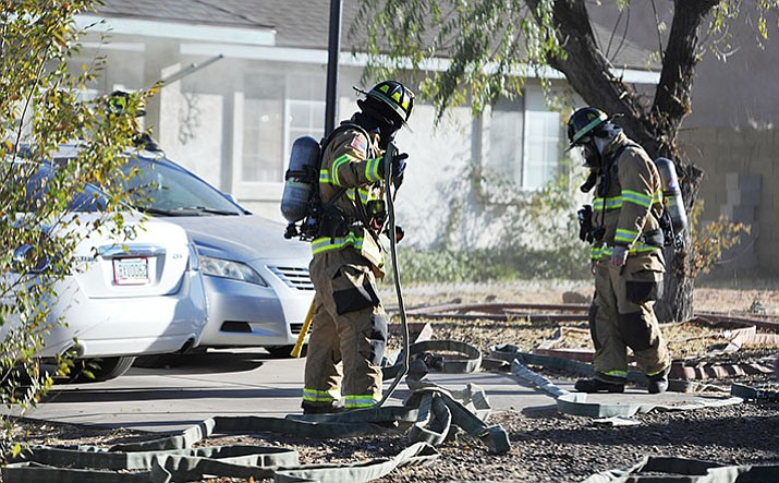 Central Arizona Fire and Medical along with Prescott fire fighters respond to a structure fire in the 2900 block of Cedar Springs Lane Thursday in Prescott Valley. (Les Stukenberg/Courier)
