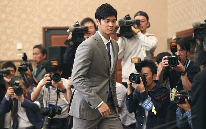 In this Nov. 11, 2017, photo, Japanese pitcher-outfielder Shohei Ohtani arrives for a press conference at the Japanese National Press Center in Tokyo. He brings his arm and bat to the Los Angeles Angels, pairing him with two-time MVP Mike Trout. (Koji Sasahara/AP)