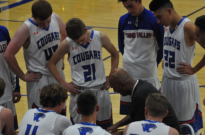 chino valley high school boys basketball coach ravi shetty talks to his team during a timeout