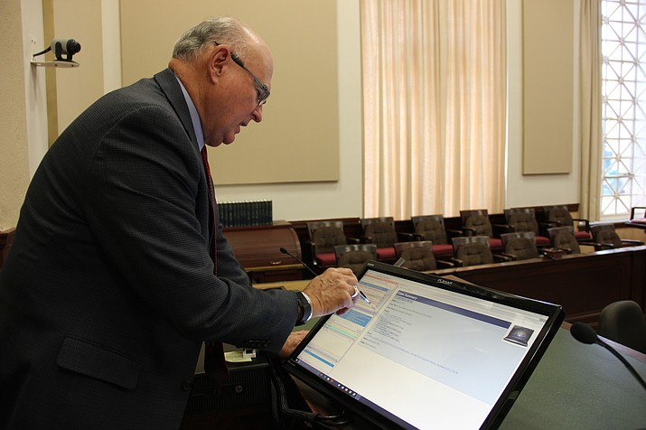 Judge David Mackey, division 1 judge for the Yavapai County Superior Court, demonstrates how eBench works in his courtroom. (Max Efrein/Courier)