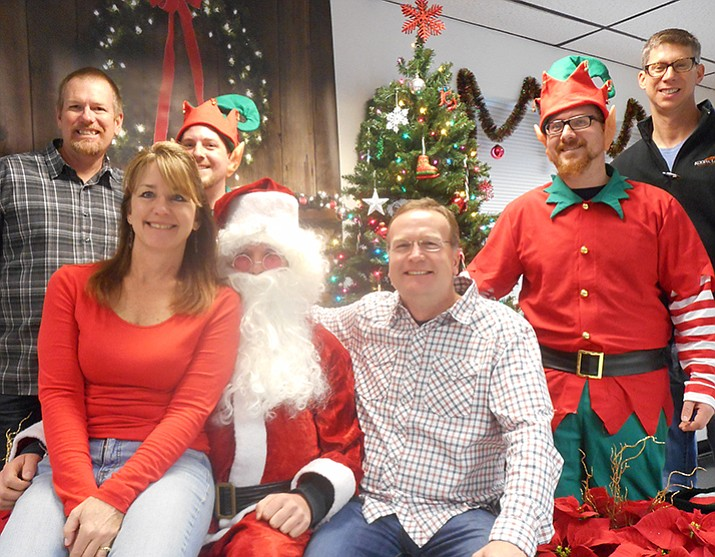 Every year at MI Windows and Doors the company brings in a Santa and Elves so employees and their families can take pictures with the iconic holiday figure.