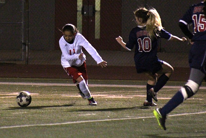 Mingus sophomore Marli Urueta evades a Don defender during the Marauders' 2-1 loss to Coronado on Friday night at home. Urueta has 14 goals in the first two weeks of the season. (VVN/James Kelley)