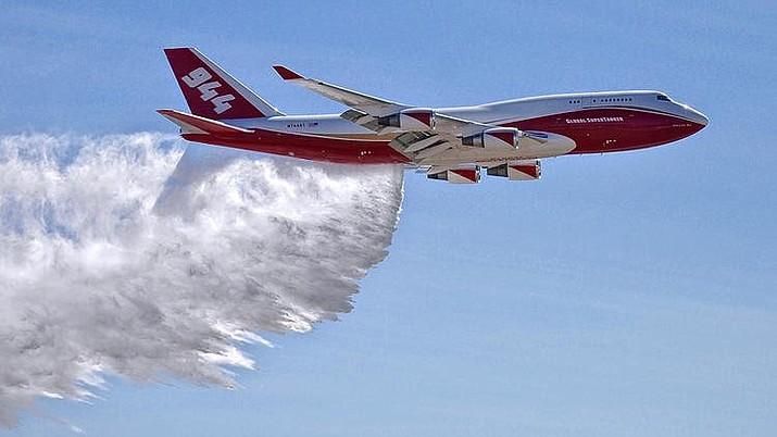 File photo provided by Global Supertanker Services shows a Boeing 747 making a demonstration water drop at Colorado Springs Airport in Colorado Springs, Colo. (Hiroshi Ando / AP 2016 File)