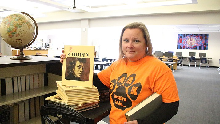 Donating for the future: A donation of reference materials to Kingman High School library by the Charles Bodden Jr. Family