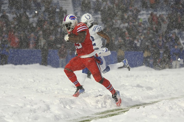 Buffalo Bills running back LeSean McCoy scores a touchdown in overtime against the Indianapolis Colts on Sunday, Dec. 10, 2017, in Orchard Park, N.Y. The Bills beat the Colts 13-7. (Adrian Kraus/AP)