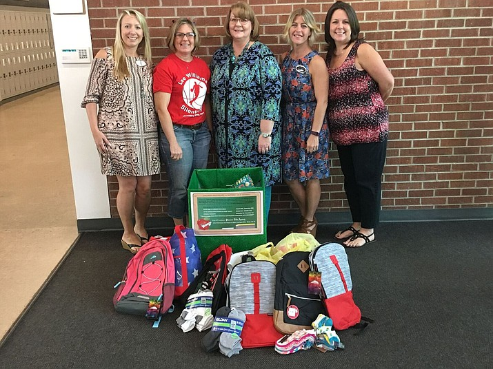 Members of the Kingman branch of Pioneer Title  adopted a third-grade classroom at Cerbat Elementary and have implemented donation drives.