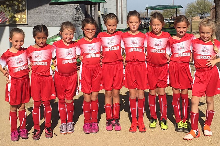 The U9 Kingman Soccer Club girls team picked up a win at the Christmas Angel Tournament.