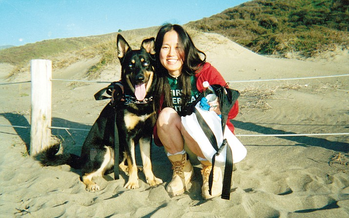 Hanamure and her dog, Blues, who she adopted on the Pine Ridge Reservation.