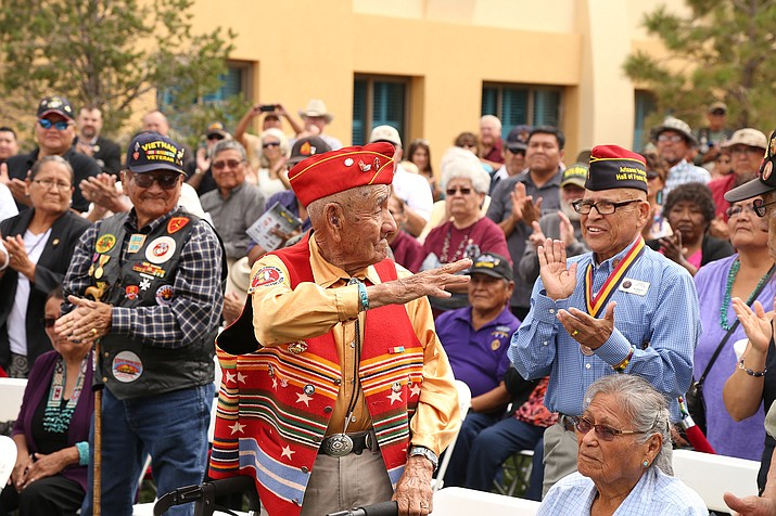 Navajo Code Talker George P. Willie Sr. waves to the crowd at the opening ceremony of The Moving Wall at Twin Arrows Navajo Casino and Resort Aug. 11. Submitted photo