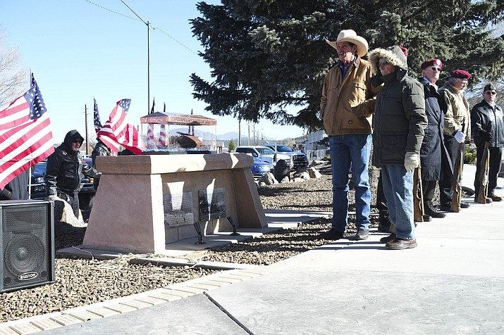 Williams Mayor John Moore and Williams WWII veteran Walter Olmsted standby as a piece of the USS Arizona is revealed at Monument park in Williams Dec. 7.