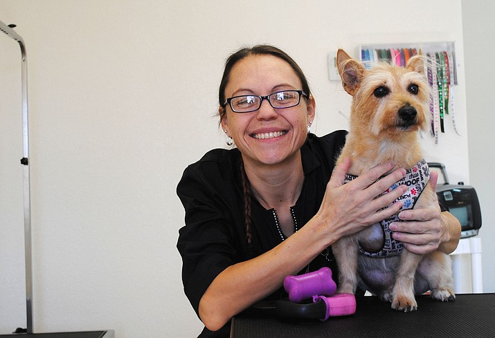 Co-owner of One Love Pet Spa Jana McClain and freshly groomed client Chloe pose for a picture. (VVN/Jennifer Volpe)