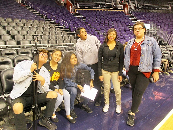 Hopi High media students on the floor at the Phoenix Suns arena known as Talking Stick Resort Arena. They are, from left, Gabriel Fredericks, Elysse Fredericks, Amber Labahe, Aidan Puhuhyesva, Cherry Jean and Hailey Kardell. Submitted photo