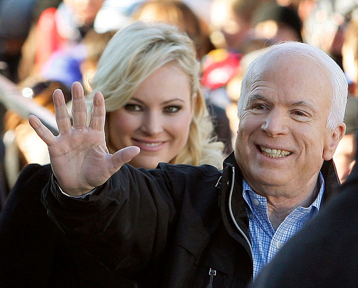 In this 2008 file photo, Republican presidential candidate Sen. John McCain, R-Ariz., accompanied by his daughter Meghan McCain, waves to supporters as he enters a campaign rally in Defiance, Ohio.  (AP Photo/Stephan Savoia)