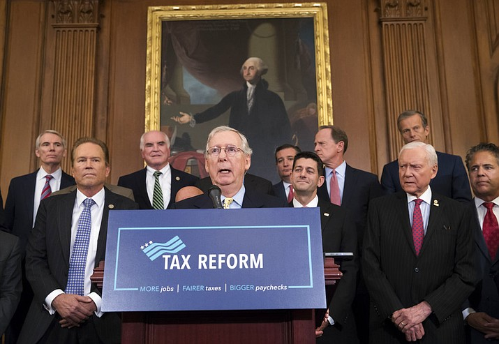 FILE - This Sept. 27, 2017 file photo shows Senate Majority Leader Mitch McConnell, R-Ky., center, joining Speaker of the House Paul Ryan, R-Wis., and other GOP lawmakers to talk about the Republicans' proposed rewrite of the tax code for individuals and corporations, at the Capitol in Washington. (AP Photo/J. Scott Applewhite, file)