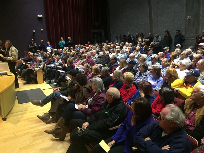Prescott Valley's Planning and Zoning meeting, Monday night, Dec. 11, was packed beyond capacity. The committee needed to turn on the TV in the overflow area. (Jason Wheeler/Tribune)