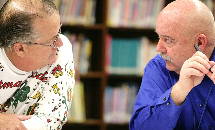 Before Tuesday's meeting, Camp Verde Unified School District Superintendent Dr. Dennis Goodwin, right, talks with Eric Lawton, one of the district's five governing board members. Tuesday, the CVUSD board voted 5-to-0 to accept Dr. Goodwin's letter of intent to not seek a contract renewal. Goodwin, whose contract expires on June 30, 2018, is in his third year as district superintendent. (Photo by Bill Helm)