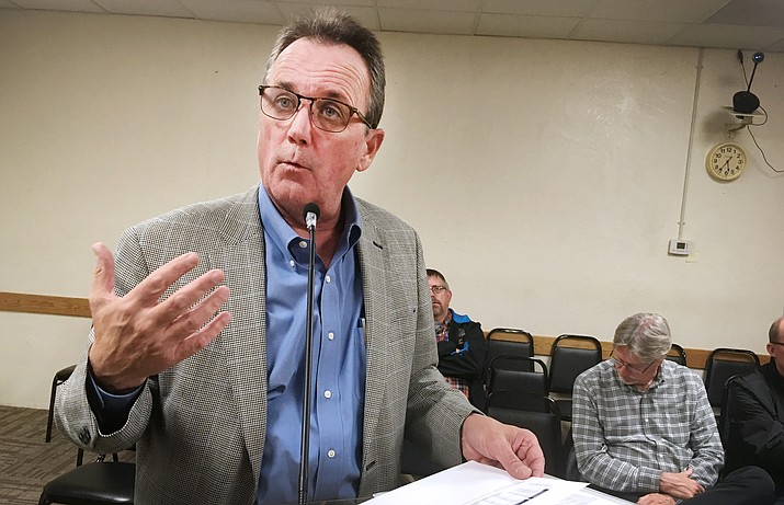 Mark Reader with brokerage and investment banking firm Stifel Nicolaus tells the Camp Verde Town Council about the roughly $85,000 the Town of Camp Verde will save by effectively refinancing two Water Infrastructure Finance Authority (WIFA) loans. (Photo by Bill Helm)