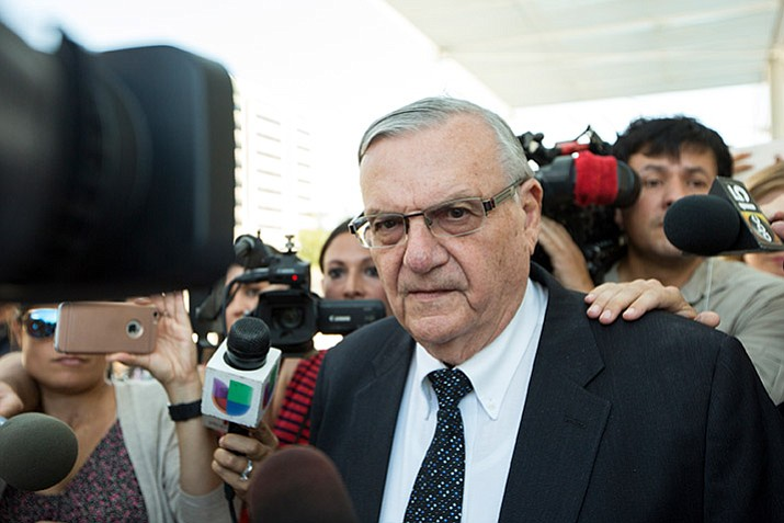 In this July file photo, former Sheriff Joe Arpaio leaves the federal courthouse in Phoenix, Ariz. (AP Photo/Angie Wang, File)