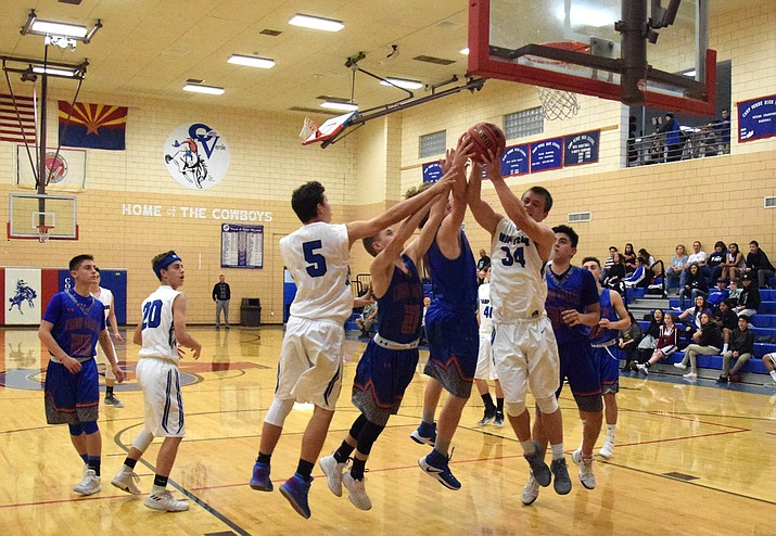 Camp Verde senior Ryan Loza grabs a rebound during the Cowboys' 64-50 win over Chino Valley at home on Tuesday night at home. (VVN/James Kelley)