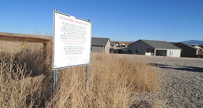 The entrance to the Iron King Trail is now surrounded by homes and will eventually have homes on both sides in the area of the new Jasper subdivision that is north and west of the newest sections of the Granville subdivision in Prescott Valley. (Les Stukenberg/Courier)
