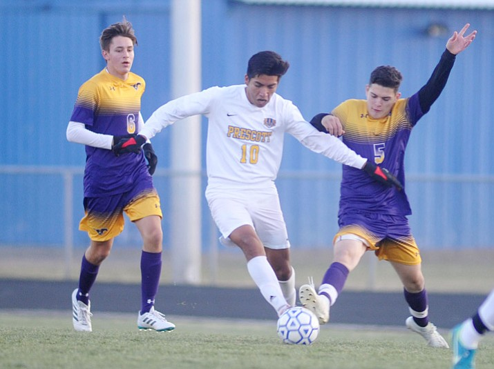 Fernando Rodriguez (10) battles for the ball as the Prescott boys' soccer team takes on Sunrise Mountain on Thursday, Dec. 14, 2017, in Prescott. (Les Stukenberg/Courier)