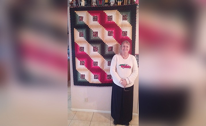 The Friends of Camp Verde Library held a holiday quilt raffle to benefit the Friends of the Camp Verde Library and the Camp Verde Quilters. Dottie Presmyk was the winner.