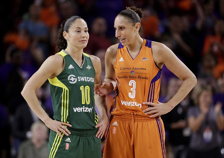 In this Sept. 6, 2017 file photo, Phoenix Mercury guard Diana Taurasi (3) talks with Seattle Storm guard Sue Bird (10) during the second half of a single-game WNBA basketball playoff matchup, in Tempe. Bird and Taurasi headline the 29 players chosen for the U.S. women's basketball team pool. Eleven members of the 2016 Olympic team that won a sixth consecutive gold medal for the Americans are in the pool that was announced Thursday, Dec. 14. (Matt York/AP, File)