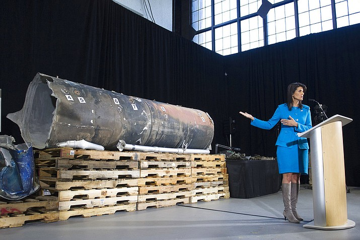 "U.S. Ambassador to the U.N. Nikki Haley gestures as she speaks in front recovered segments of an Iranian rocket during a press briefing at Joint Base Anacostia-Bolling, Thursday, Dec. 14, 2017, in Washington. Haley says ""undeniable"" evidence proves Iran is violating international law by funneling missiles to Houthi rebels in Yemen. (AP Photo/Cliff Owen)"