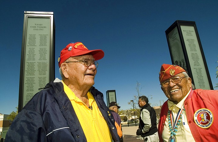 FILE--In this Oct. 28, 2006, file photo, Navajo Code Talkers Keith Little, left, and Teddy Draper Sr., joke around during the filming of a documentary about them in Gallup, N.M. Draper, who was part of the 5th Marine Division, fought in the Battle of Iwo Jima and received a Purple Heart as well as a Congressional Silver Medal died Thursday, Dec. 14, 2017, at age 96 in Prescott, Ariz. (AP Photo/Donovan Quintero, file)