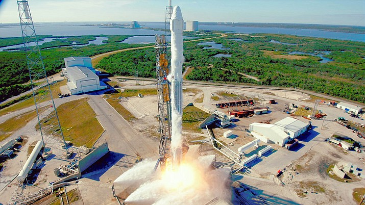 This photo provided by NASA, the SpaceX Falcon 9 rocket with the Dragon spacecraft launches from Space Launch Complex 40 at Cape Canaveral, Fla. (NASA via AP)