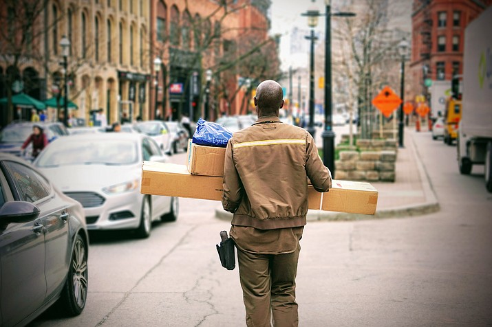 Holiday deliveries add pressure to big retailers, as they have one less day to deliver this year. (Maarten van den Heuvel, Unsplash)