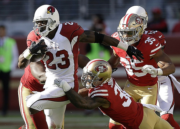 In this Sunday, Nov. 5, 2017, file photo, Arizona Cardinals running back Adrian Peterson (23) runs against the San Francisco 49ers during the first half of an NFL football game in Santa Clara, Calif. Adrian Peterson was placed on injured reserve Friday, Dec. 15, 2017, because of a neck injury, ending the running back's season after only six games with the Arizona Cardinals.