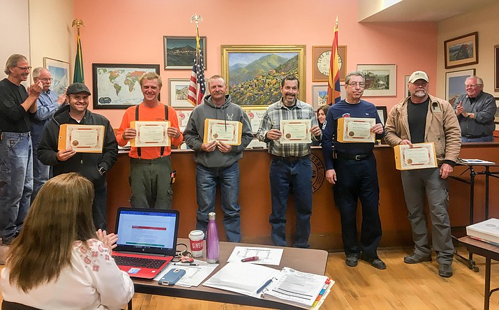 At the Dec. 12 meeting, Jerome council recognized the town crew, fire department and police department for their aid in putting out the fire on Verde Street on Nov. 29. From left to right: Garrett Greeneltch, Sean Bauer, Marty Boland, Joe Lazaro, Ron Chilston, Allen Muma. Not pictured but recognized: Lyle Keith. VVN/Halie Chavez