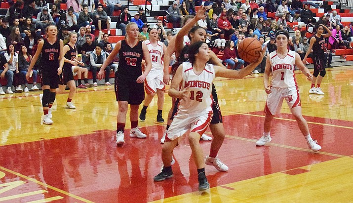 Mingus junior Sarah Williams grabs a rebound during the Marauders' 56-47 loss to Bradshaw Mountain on Friday night at home. (VVN/James Kelley)