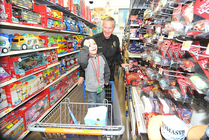 Shop with a Cop held their annual shopping spree for 115 children at the Walmart on Gail Gardner Way in Prescott Saturday morning. Officers from 12 local agencies took the children with $250 to spend shopping, then a breakfast, visit with Santa and a ride in their patrol vehicles. (Les Stukenberg/Courier)