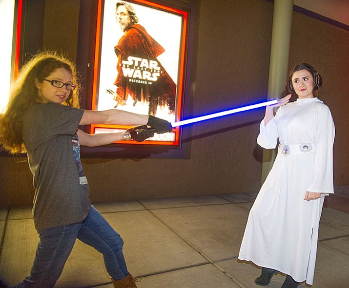 "Kristin Potts, left, from Dewey, brought her light sabre on opening night of Star Wars ""The Last Jedi,"" and faced off with resident Alicia Hull, who dressed as Princess Leia, at the Harkins Theatres in Prescott Valley Thursday night."