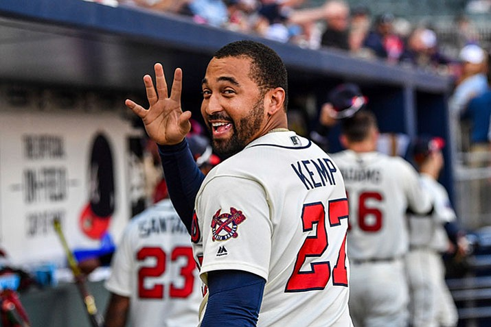 In this June 24, 2017, file photo, Atlanta Braves' Matt Kemp waves to a fan after the team's baseball game against the Milwaukee Brewers in Atlanta. Kemp is returning to the Los Angeles Dodgers as part of a five-player trade with the Atlanta Braves that includes cash. (AP Photo/Danny Karnik, File)