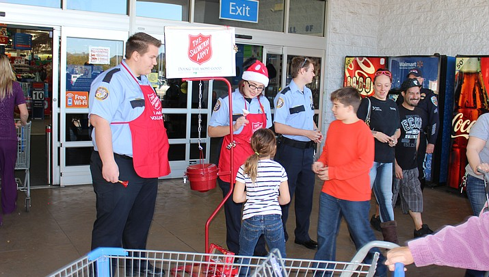 A friendly Red Kettle contest between Kingman police and fire departments