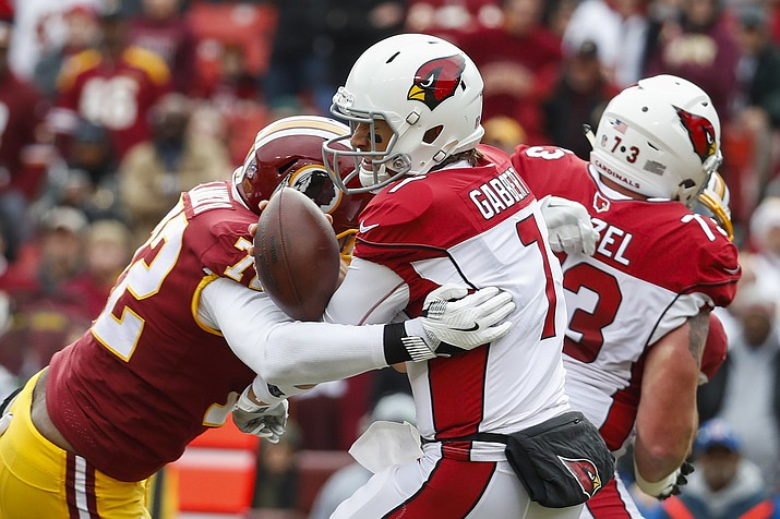 Washington Redskins defensive lineman Anthony Lanier (72) sacks Arizona Cardinals quarterback Blaine Gabbert (7), forcing a fumble and a turnover resulting in a Redskins touchdown during the first half of an NFL football game in Landover, Md., Sunday, Dec 17. (Alex Brandon/AP)