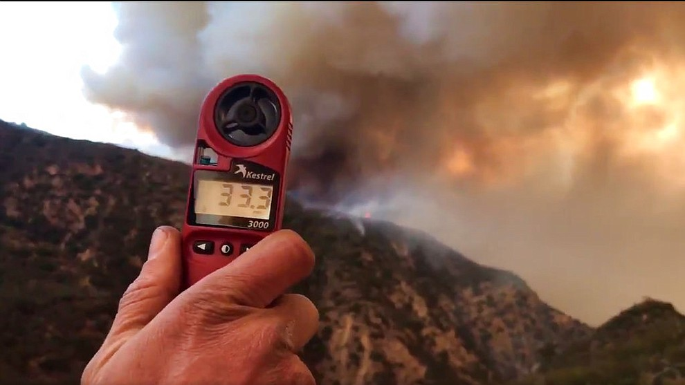 In this image from video provided by the Santa Barbara County Fire Department, a wind speed indicator held by a U.S. Forest Service fire fighter on Gibraltar Road at the W. Fork of Cold Spring Trail, shows just how fast and varied the speed of the wind is blowing down canyon. In this video it varied from 10-33 mph in Santa Barbara, Calif., Saturday, Dec. 16, 2017. Wind gusts of up to 52 mph have been recorded in the area using a hand held weather device. The Office of Emergency Services announced the orders Saturday as Santa Ana winds pushed the fire close to the community. The mandatory evacuation zone is now 17 miles long and up to 5 miles wide, extending from coastal mountains northwest of Los Angeles to the ocean. Winds in the foothill area are hitting around 30 mph, with gusts up to 60 mph. (Mike Eliason/Santa Barbara County Fire Department via AP)