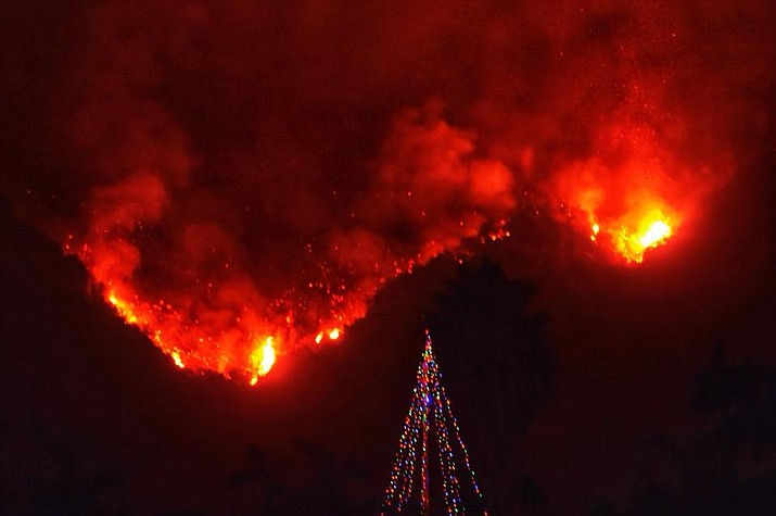 A Christmas tree in front of the Thomas Fire.