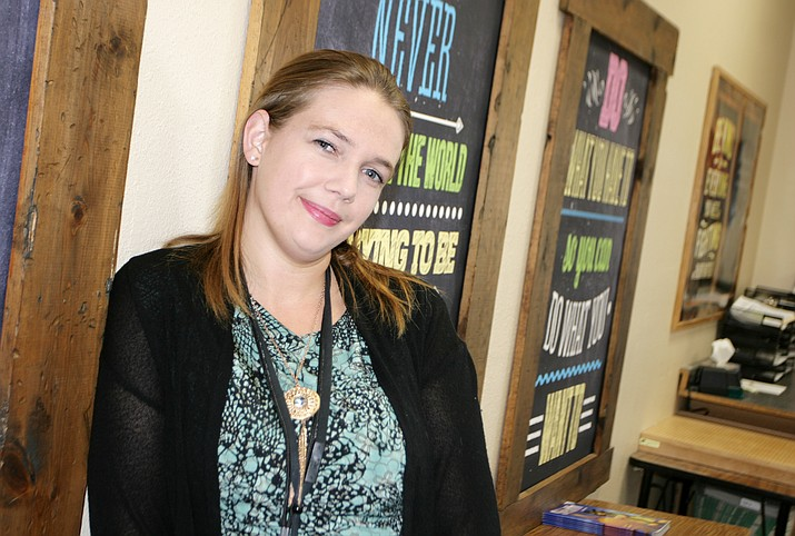 Having a son with a learning disability led Ashley Sherman to become a paraprofessional at Cottonwood's American Heritage Academy. Sherman would like to eventually become a kindergarten teacher. (Photo by Bill Helm)