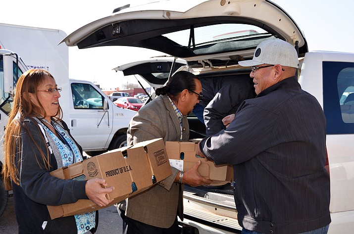 Council Delegates Raymond Smith, Jr. and Herman Daniels, Jr. (right) help NAAA staff members load turkeys for 80 Navajo senior centers in Window Rock, Arizona Dec. 14. Submitted photo