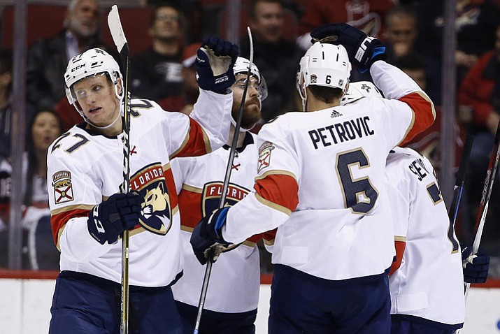 Florida Panthers center Nick Bjugstad (27) celebrates his goal against the Arizona Coyotes with defenseman Ian McCoshen, second from left, defenseman Alexander Petrovic (6) and center Colton Sceviour, right, during the second period of an NHL hockey game, Tuesday, Dec. 19, 2017, in Glendale. (Ross D. Franklin/AP)