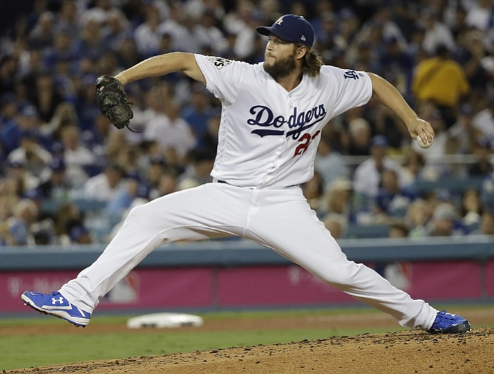 In this Wednesday, Nov. 1, 2017 file photo, Los Angeles Dodgers' Clayton Kershaw makes a relief appearance during the third inning of Game 7 of baseball's World Series against the Houston Astros in Los Angeles. The Los Angeles Dodgers will pay baseball's highest luxury tax for the fourth straight year and the New York Yankees owe a penalty for a 15th consecutive season, streaks that could end as the sport's biggest spenders slash payroll for 2018. (David J. Phillip/AP, File)