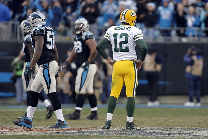Green Bay Packers' Aaron Rodgers (12) watches as Carolina Panthers players walk off the field after a Green Bay Packers fumble late during the second half Sunday, Dec. 17, 2017, in Charlotte, N.C. (Bob Leverone/AP)