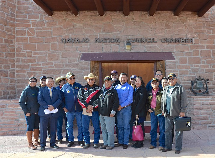 Council Delegates Tom Chee and Seth Damon with Navajo veterans following the Naabik'íyáti' Committee's unanimous vote in support of overriding the veto of the Navajo Nation Veterans Trust Fund Income Act Dec. 4. Submitted photo