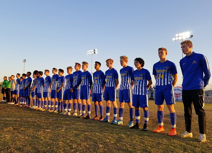 Members of the Prescott boys' soccer team line up for the national anthem prior their matchup with Moon Valley on Tuesday, Dec. 19, 2017, in Phoenix. The Badgers edged the Rockets 3-2. (PHS Athletics/Courtesy)